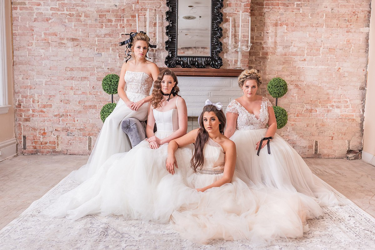 Four models wearing wedding dresses from bridal shops in pittsburgh pa