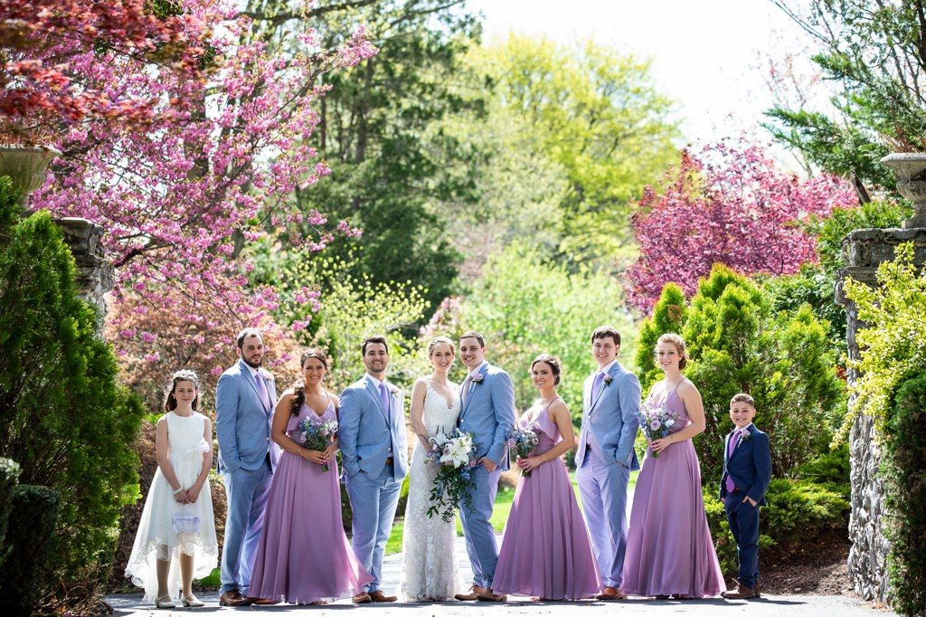 a bridal party posing with spring flowers at linwood estate