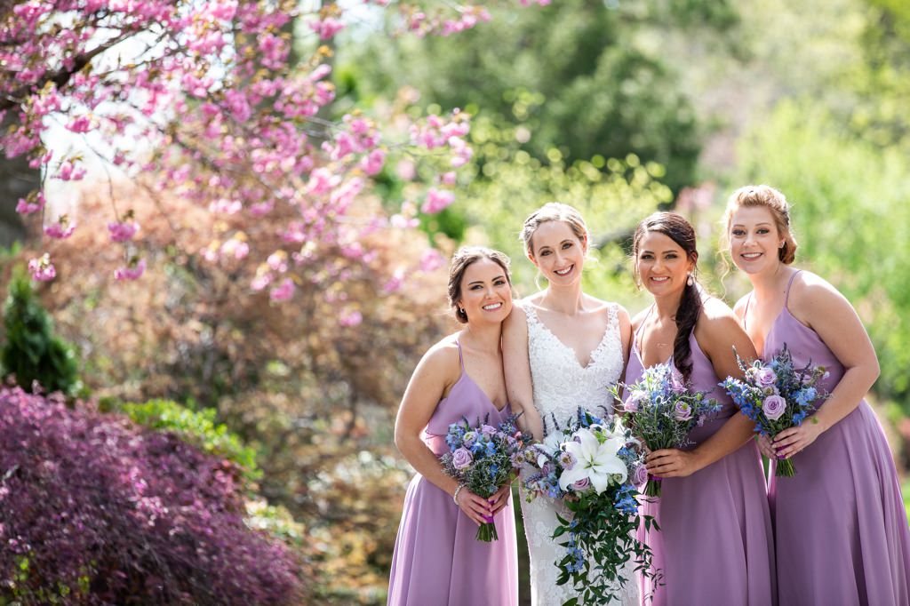 bridesmaids posing at linwood estate in the spring blossoms