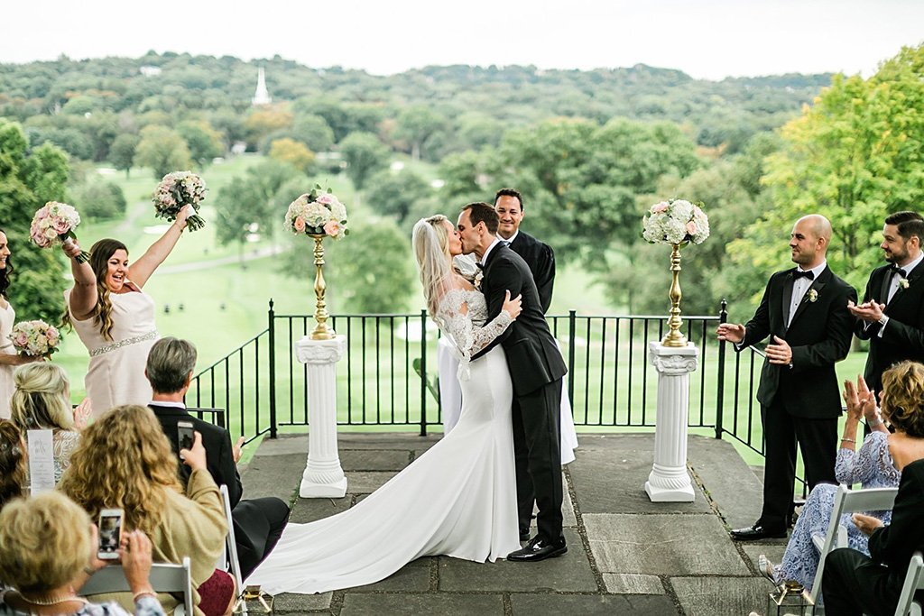 bride and groom having their first kiss