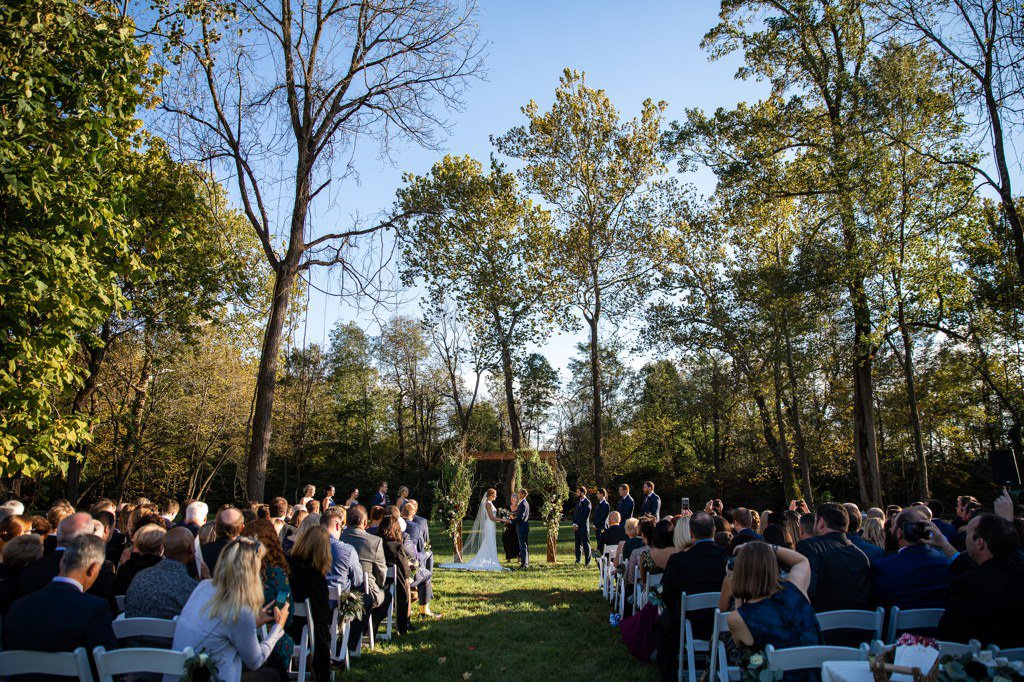 A wedding ceremony taking place at Allenberry Resort, one of the many wedding venues in Harrisburg, PA