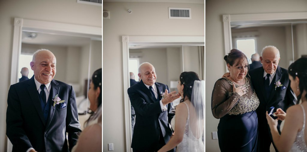 A dad and mom and seeing their daughter for the first look on her wedding day.