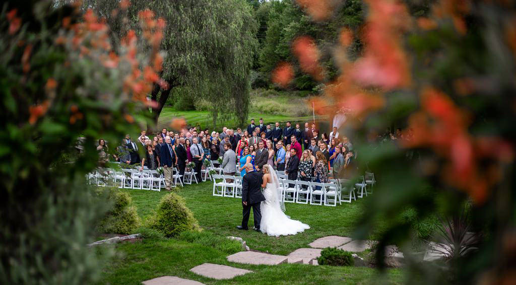 A wedding ceremony at Historic Acres of Hershey, one of the most beautiful wedding venues in Harrisburg, PA