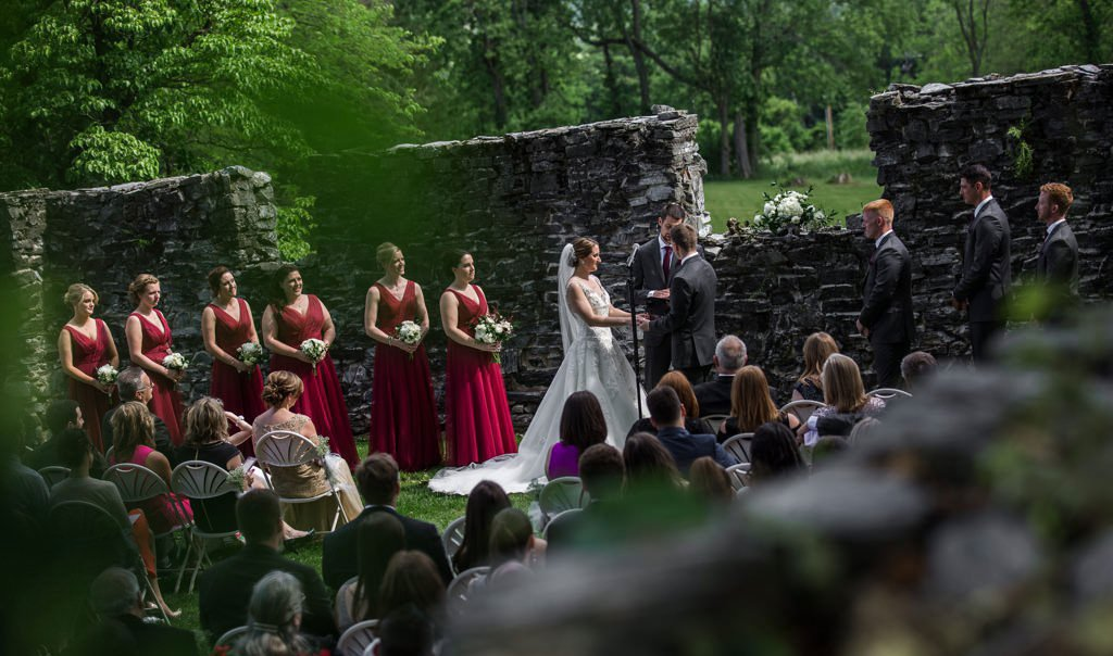 A wedding ceremony taking place at Stock's Manor, one of the many wedding venues in Harrisburg