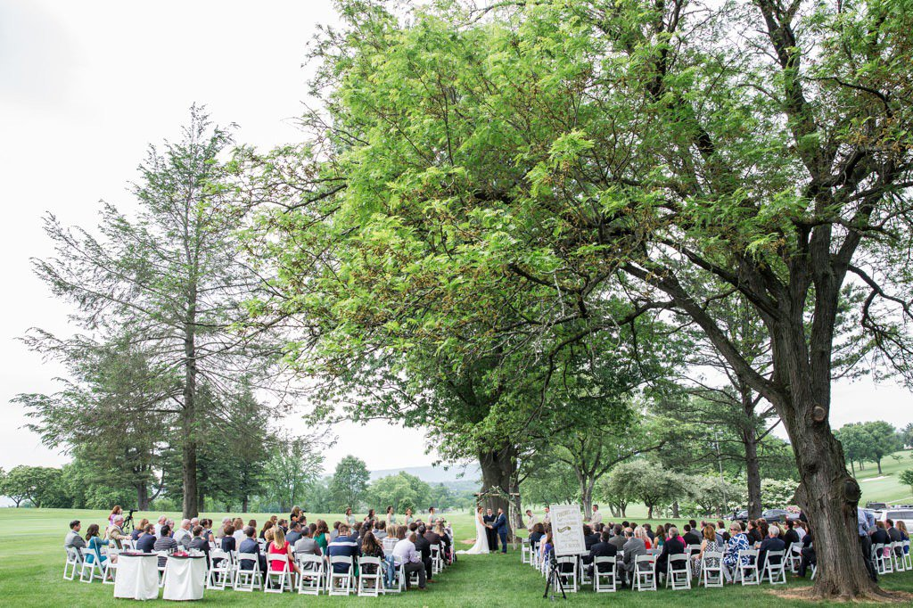 A wedding ceremony taking place at West Shore Country Club, a wedding venue in Camp Hill, PA