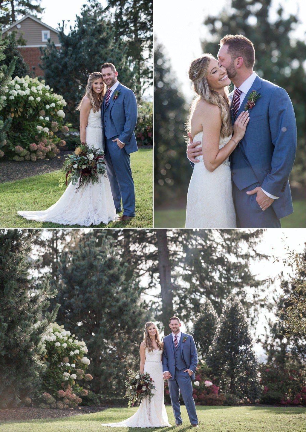 A bride and groom posing for photos at their Wyndridge Farm wedding in Dallastown, PA