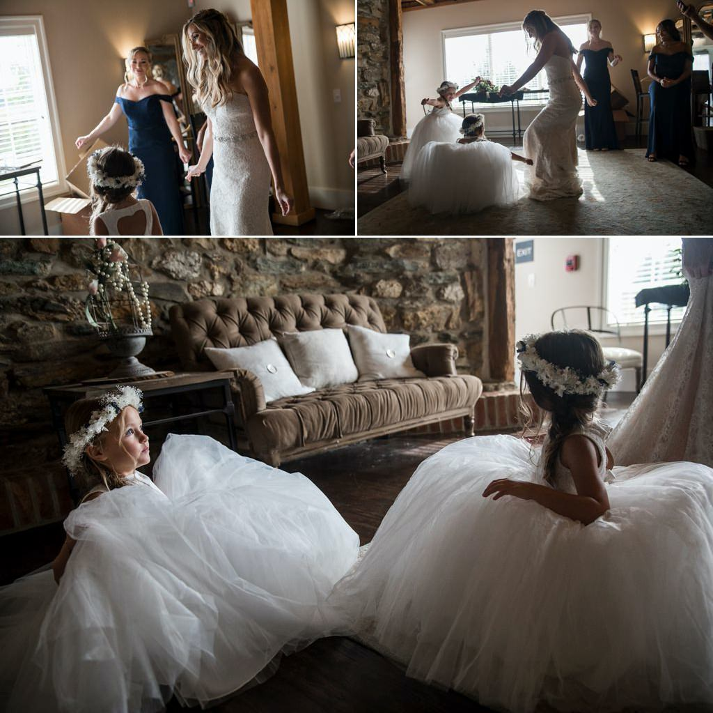 A bride dancing with flower girls in the bridal suite before her Wyndridge Farm wedding