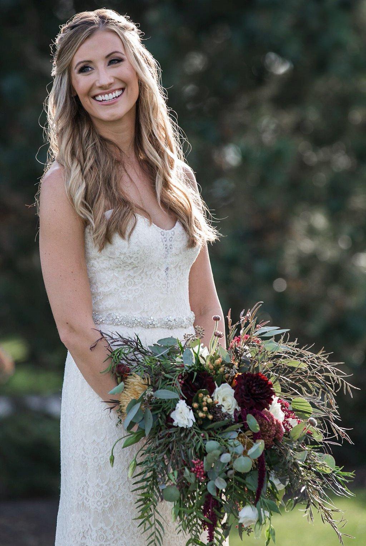 A bride posing for photos at her Wyndridge Farm wedding