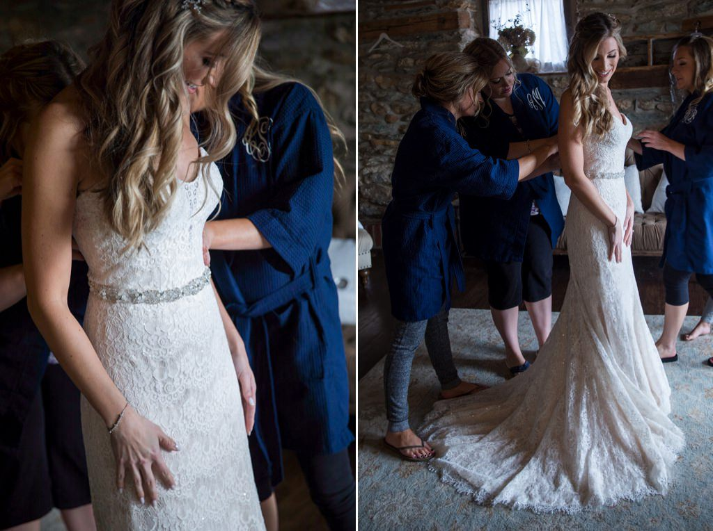 Bride putting on her dress at her Wyndridge Farm wedding