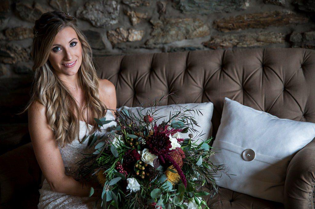 A bride posing in the bridal suite of Wyndridge Farm