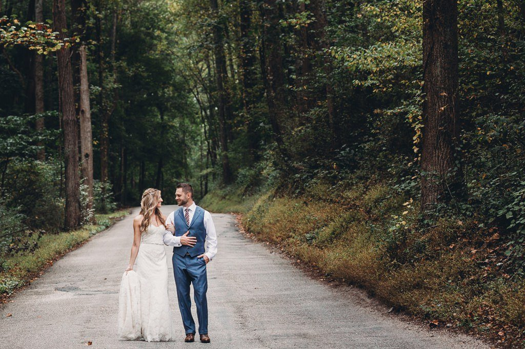 A bride and groom walking down a road in York County PA