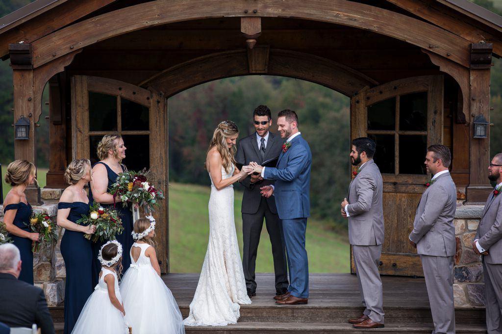 Exchanging wedding rings at a Wyndridge Farm wedding