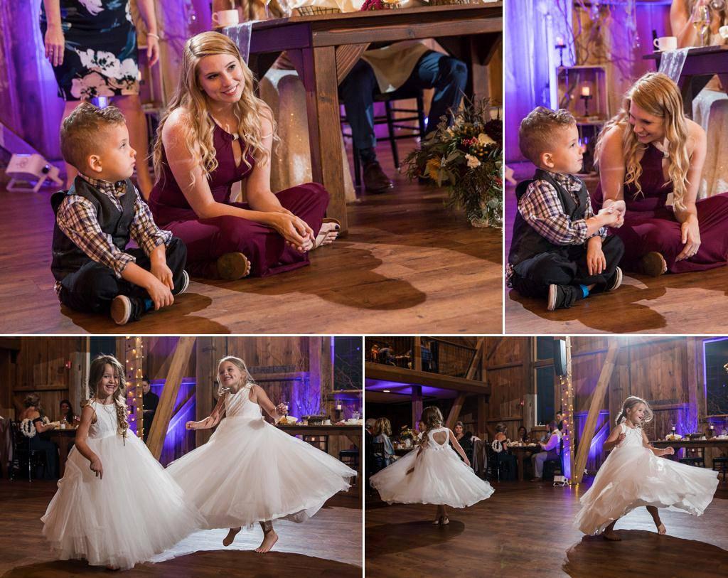Flower girls dancing at a wedding reception at Wyndridge Farm