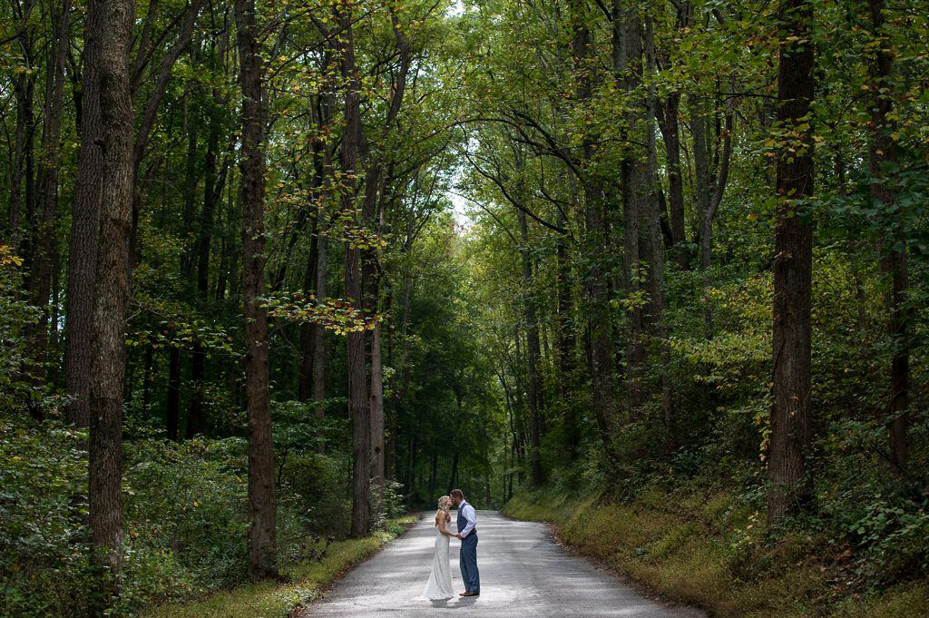 A bride and groom kissing on a back road in York County, PA