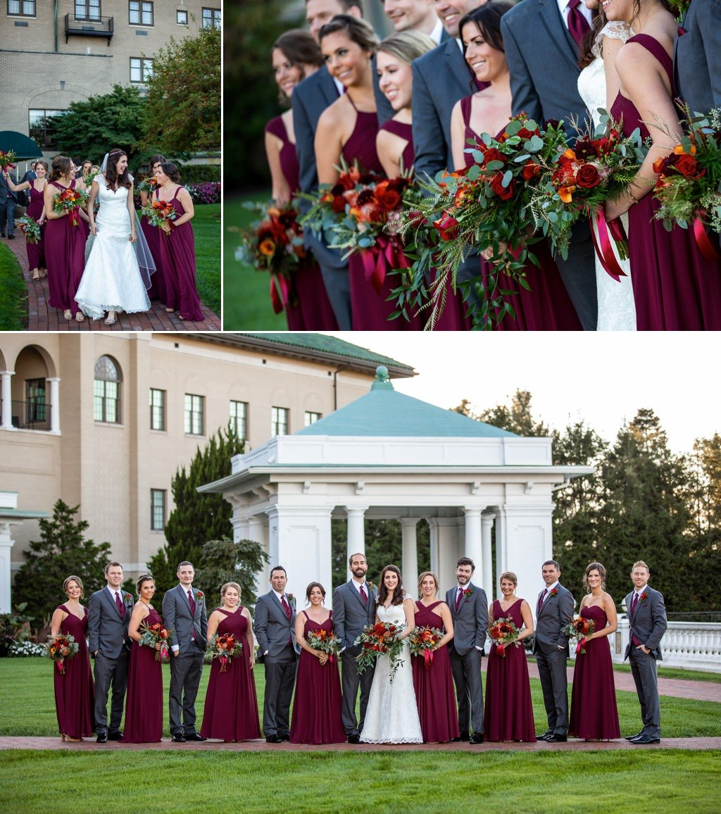 A bridal party posing for photos in The Formal Gardens of The Hotel Hershey