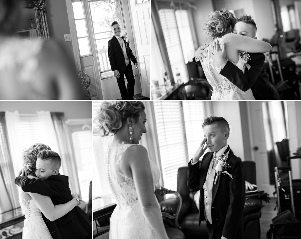 A bride doing a first look with her son on the wedding day