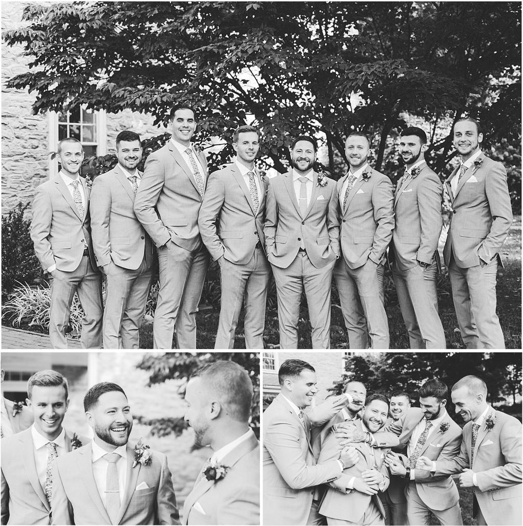 Groom and groomsmen posing for pictures