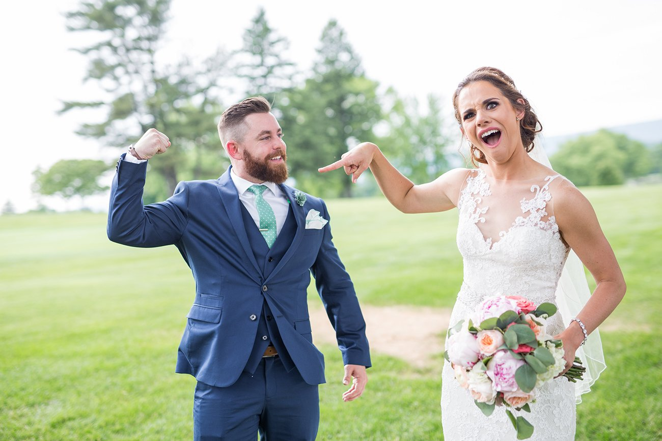 A bride making a funny face at the groom after hearing his answers to the he said she said bridal shower game.