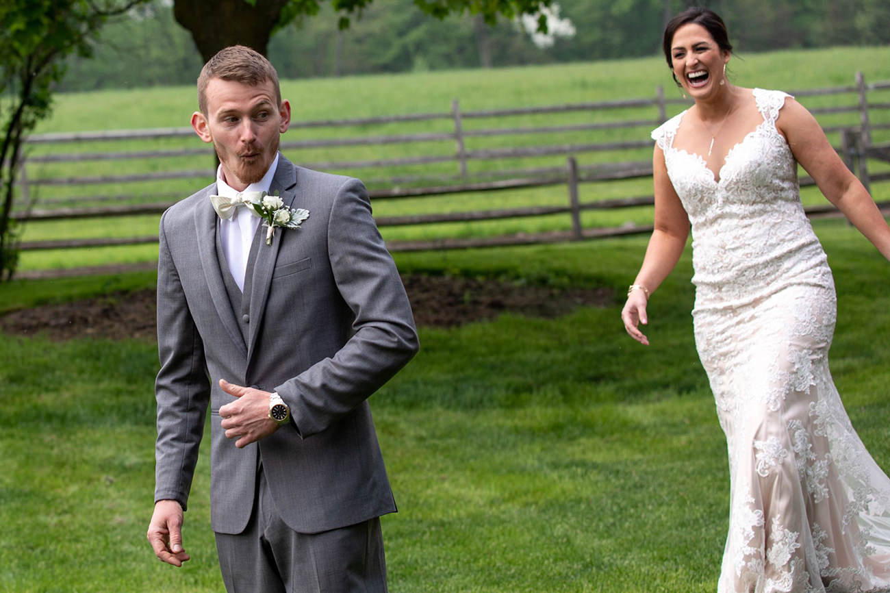 A bride sneaking up on the groom to be funny