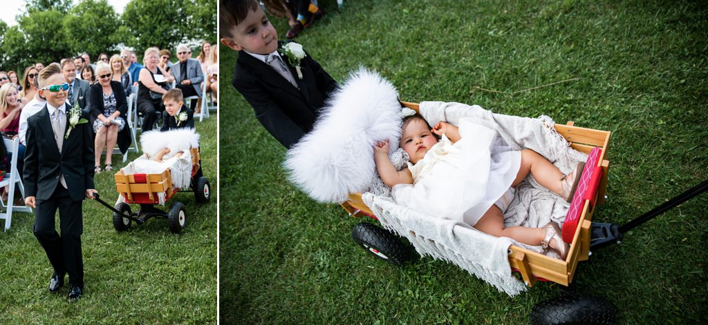 Kids walking down the aisle at an outdoor wedding ceremony