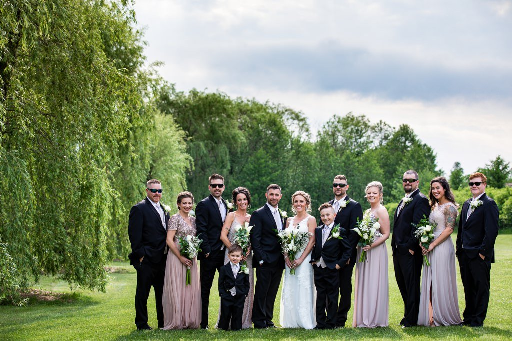 A wedding party posing for a photo at Wind in the Willows