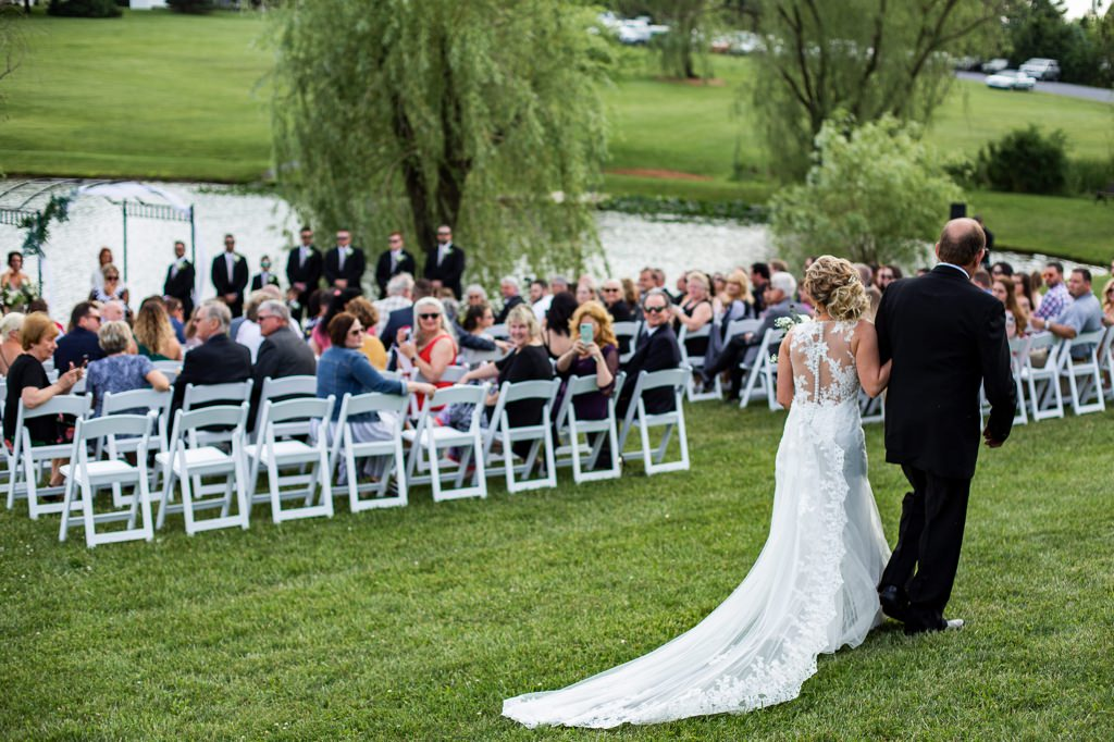 The bride and her father walking down the aisle at a Wind in the Willows wedding ceremony