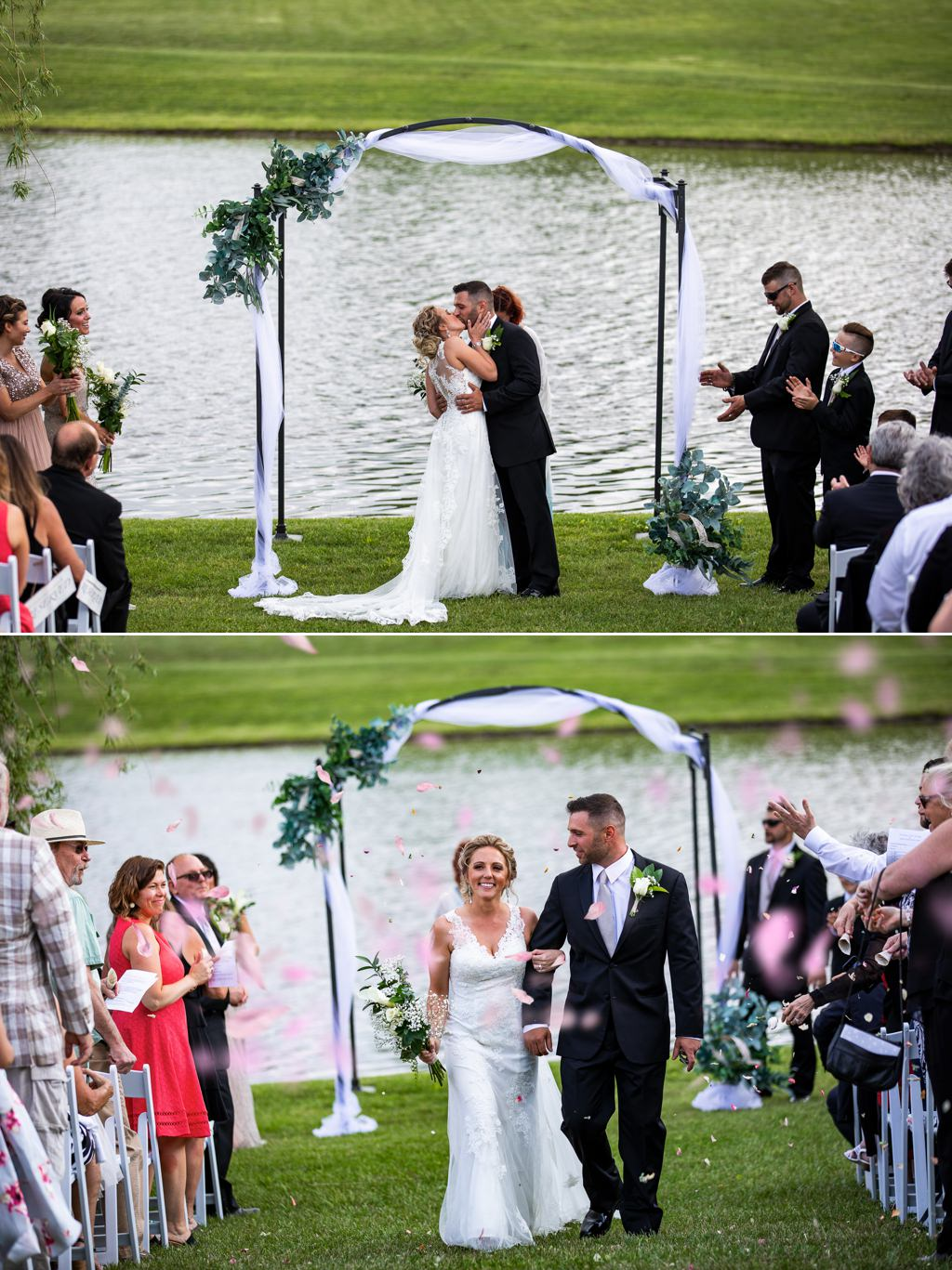 A bride and groom kissing while guests toss flower petals at them