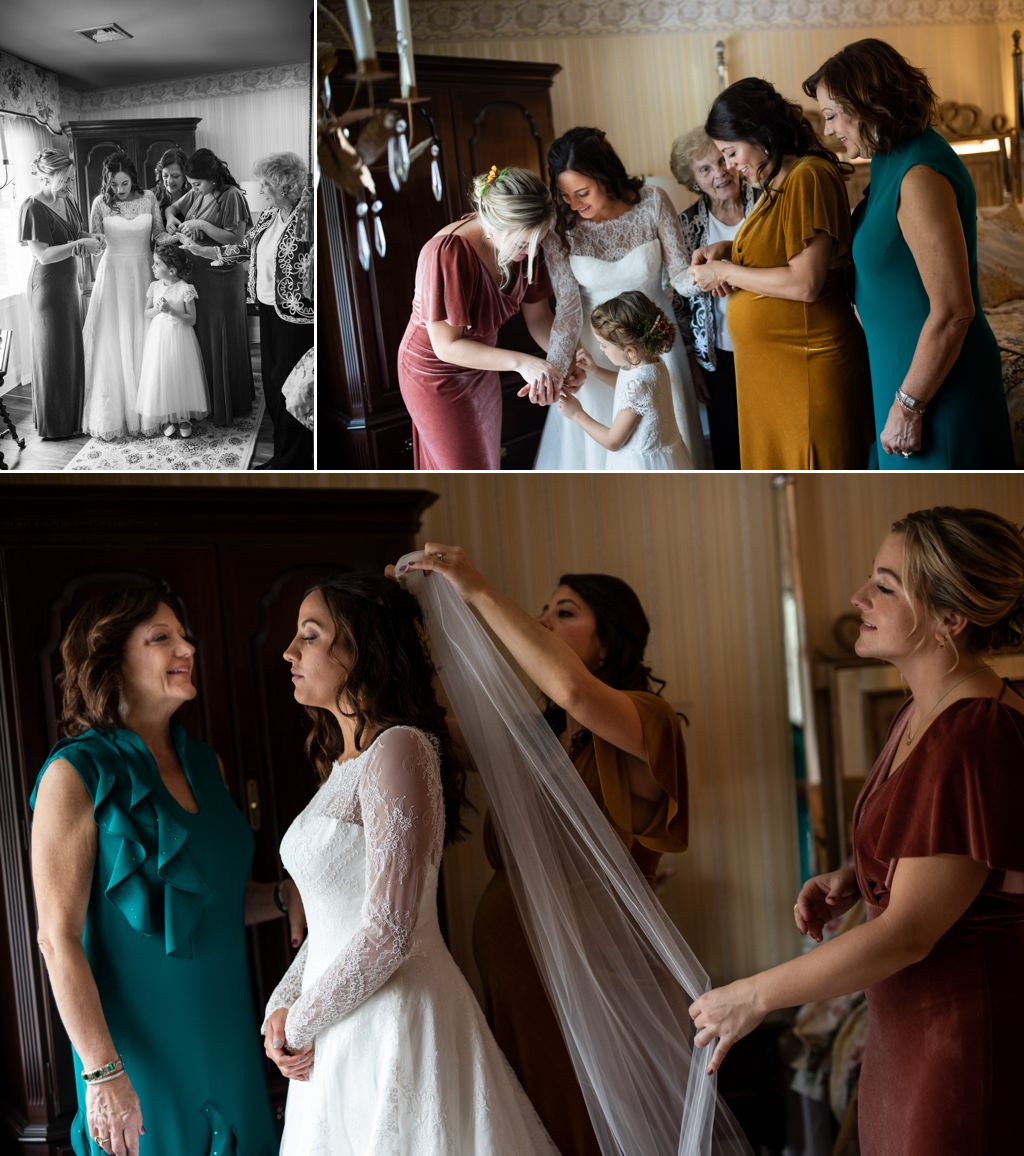 A bride getting into her wedding dress with her mom sister and grandmother
