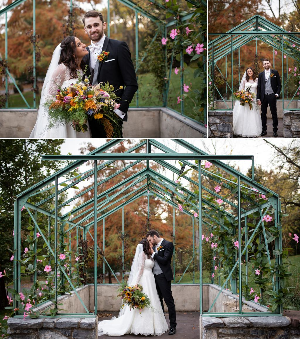A bride and groom posing for photos in the greenhouse at this historic acres of hershey pa wedding