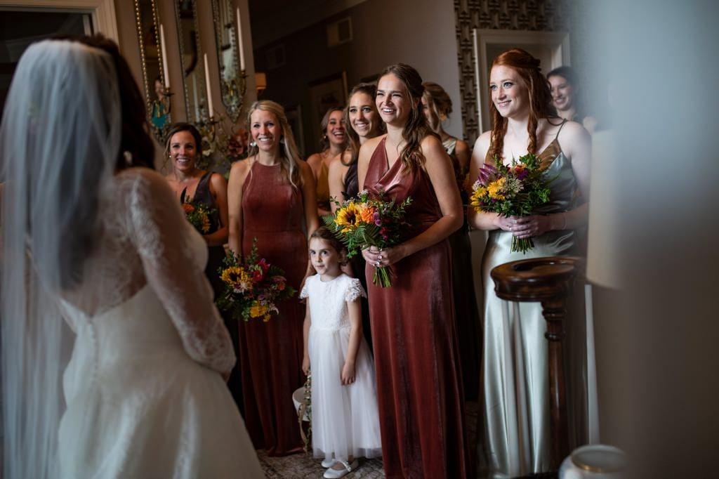 bridesmaids reaction to seeing bride in her wedding dress