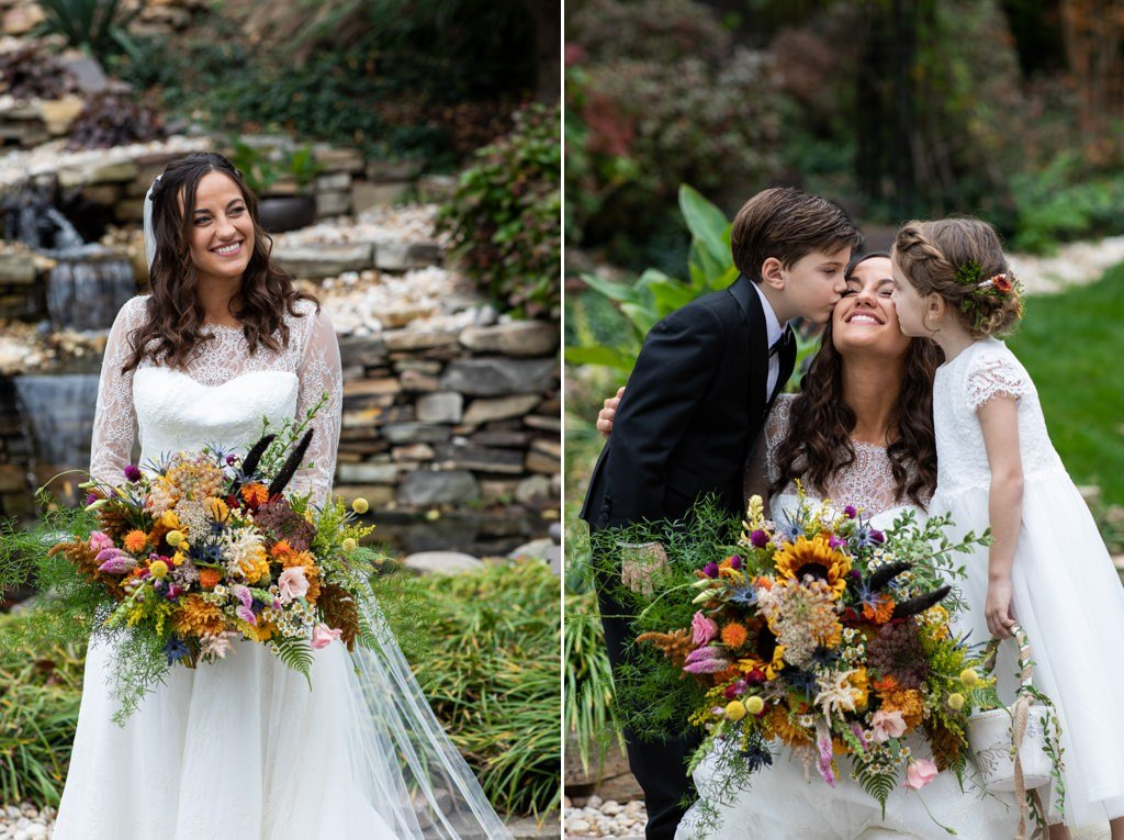 A bride being kissed by ring bearer and flower girl
