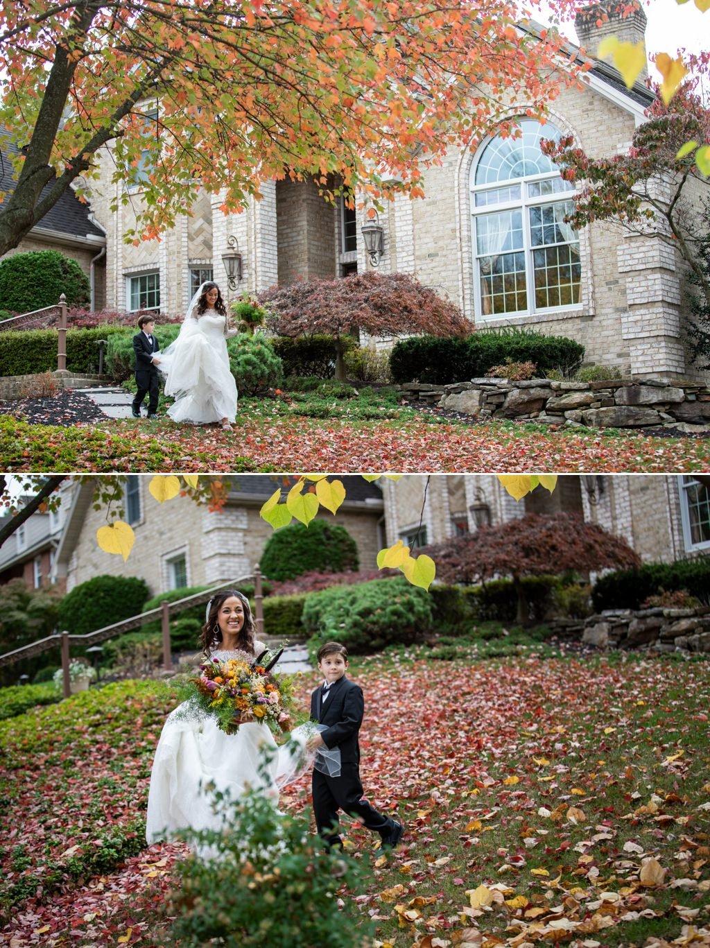 A ring bearer carrying the bride's wedding dress veil