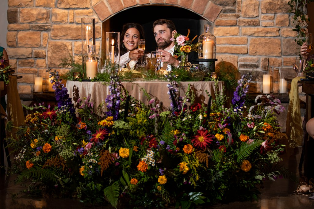 A bride and groom sharing a toast at historic acres of hershey wedding