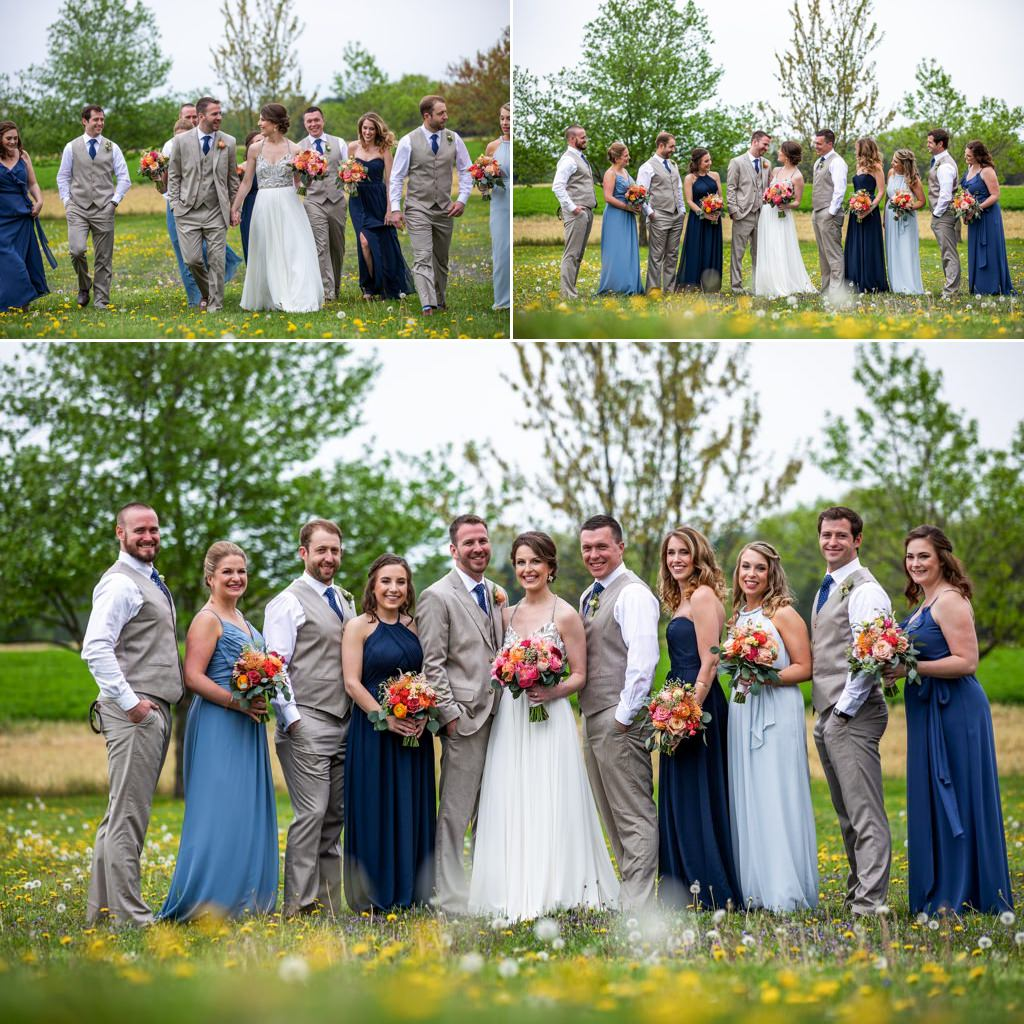 A bridal party posing for photos in a field at The Barn at Silverstone