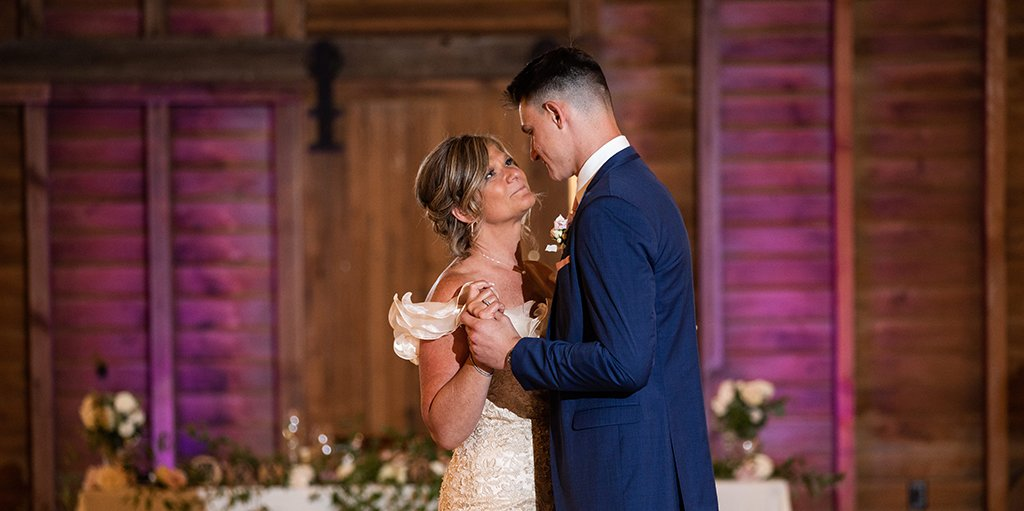 A mother and son dancing together at the wedding reception. They are dancing to their favorite two songs.