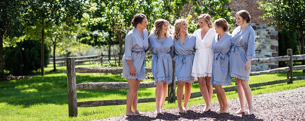 A bridal party wearing robes talking about the funny bridal shower games they played at the bride's shower