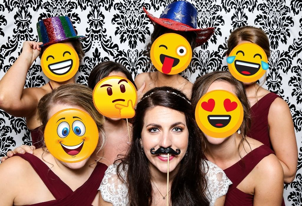 A funny photo of a bride and her bridal party wearing emoji masks. This is for the emoji bridal shower Pictionary game.