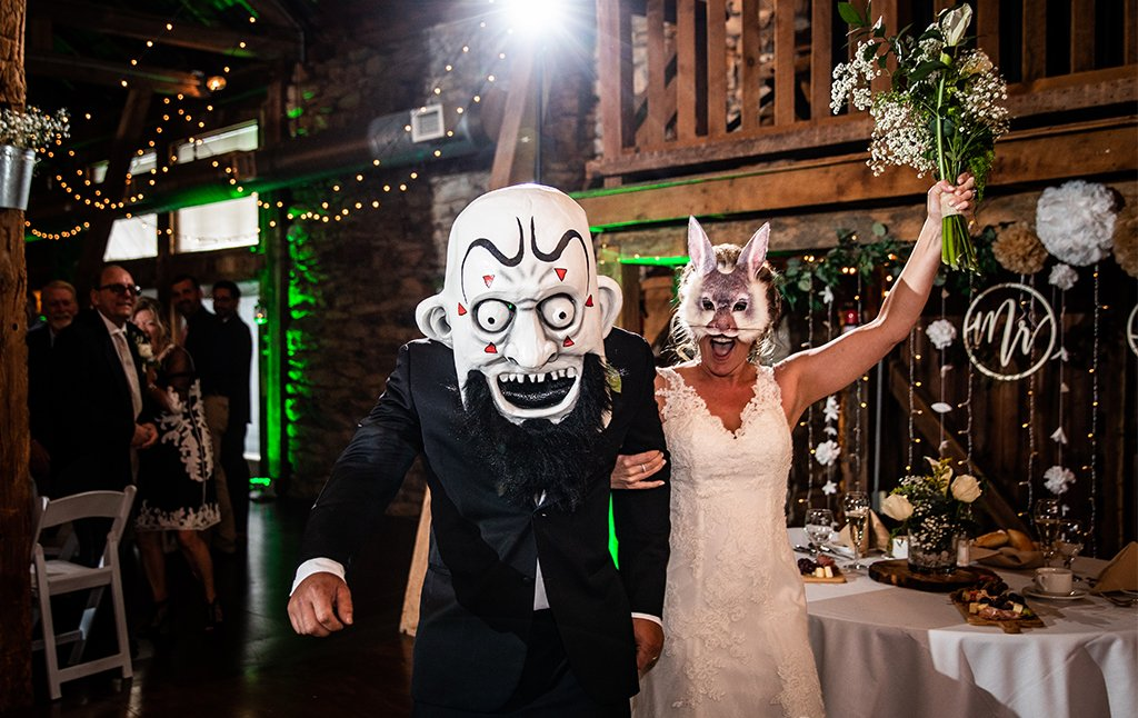 a photo of a bride and groom wearing a heavy metal mask for their wedding entrance. This is for the post about heavy metal and hard rock songs.