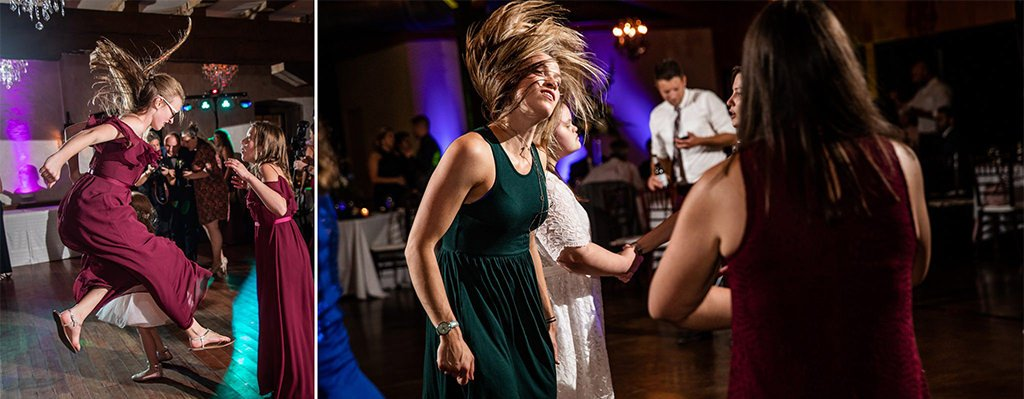 A photo of a girl jumping in the air and flipping her around on the dance floor at a wedding reception.