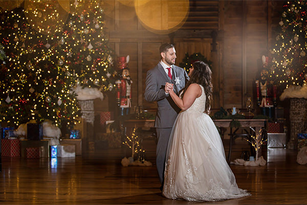 a couple dancing at their wedding reception to the best ceremony and reception songs