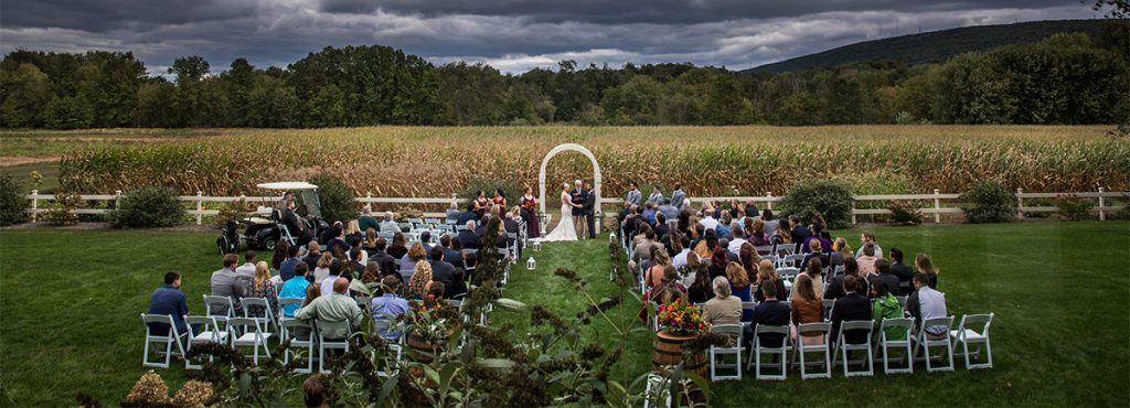 a backyard wedding near a cornfield. This is an overhead view of the ceremony taking place.