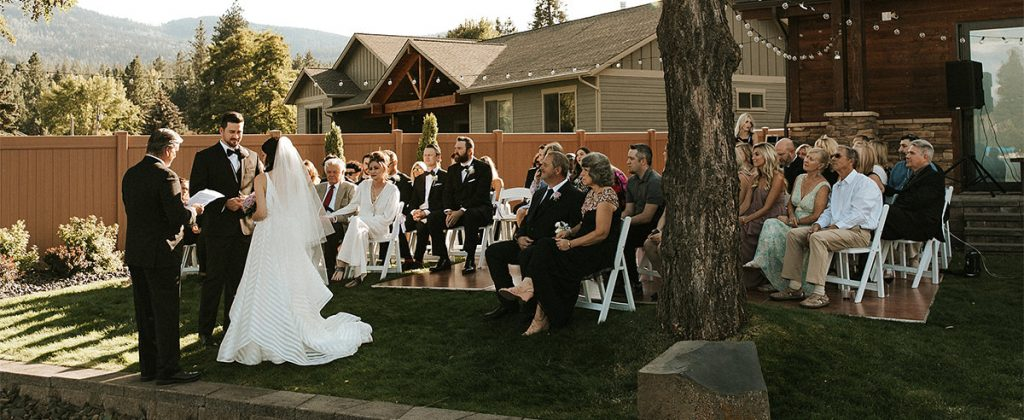 A bride and groom getting married in their own backyard