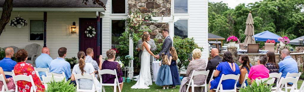 a couple getting married in their own backyard. This is the wedding ceremony