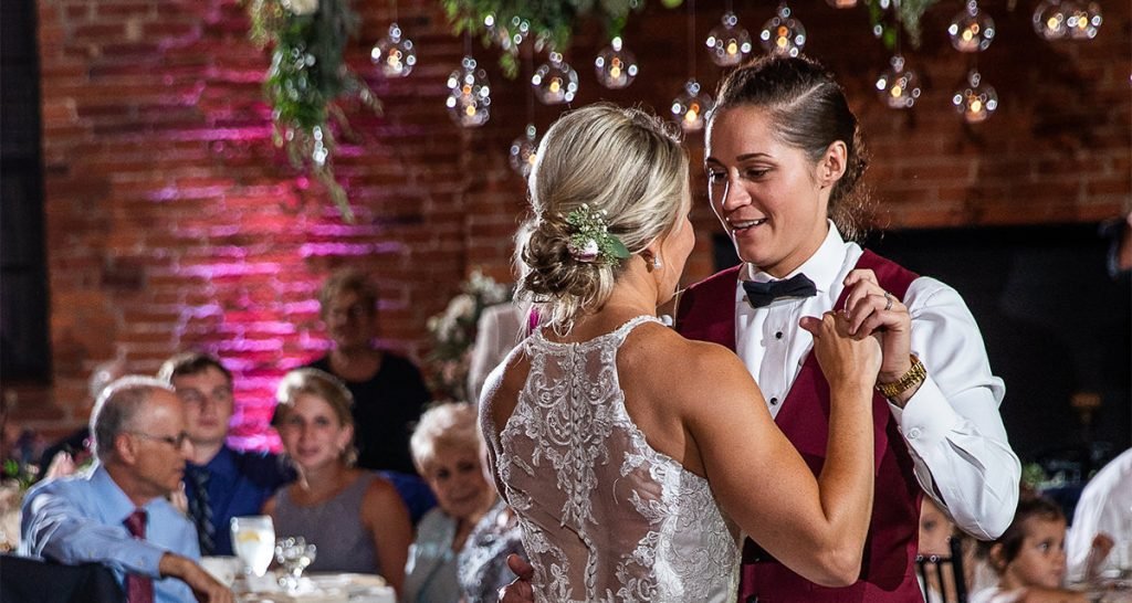 Two brides doing a first dance at their wedding to a favorite song