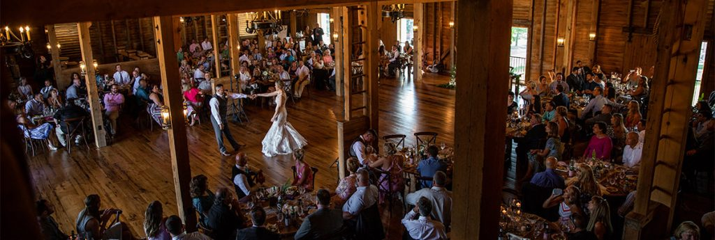 A bride and groom doing their first dance to michael buble at their wedding reception.