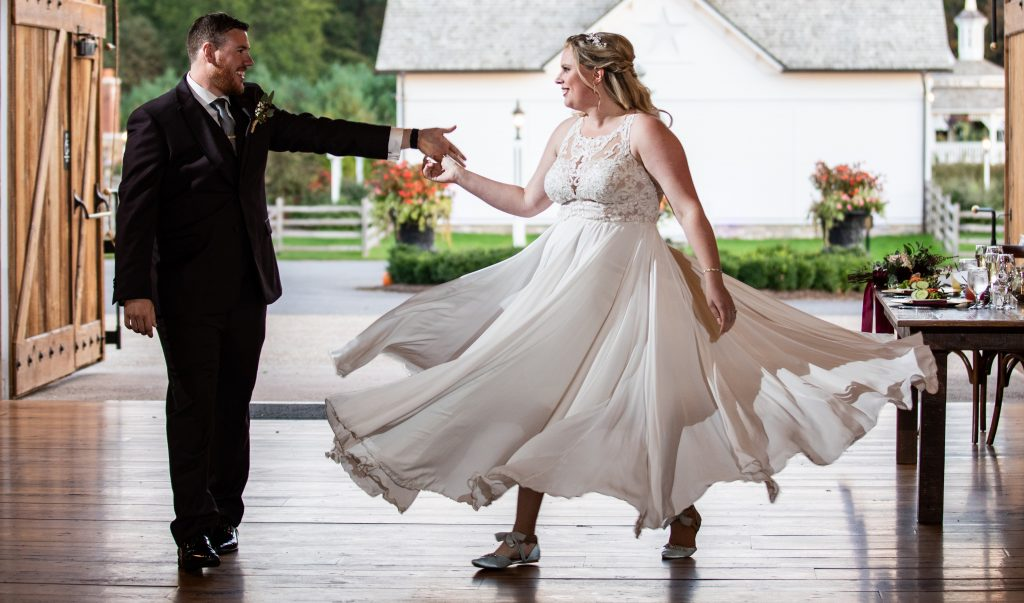 A bride doing a spin during her wedding first dance.