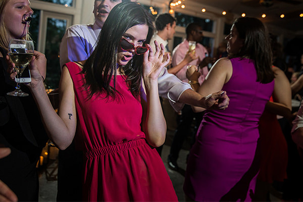 a girl dancing to pop punk songs at a wedding reception