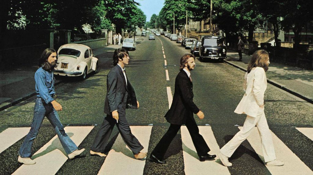 The Beatles Abbey Road photo. Shows the band walking accross the street. I am using this photo as the cover photo fro my post on the best wedding songs by The Beatles