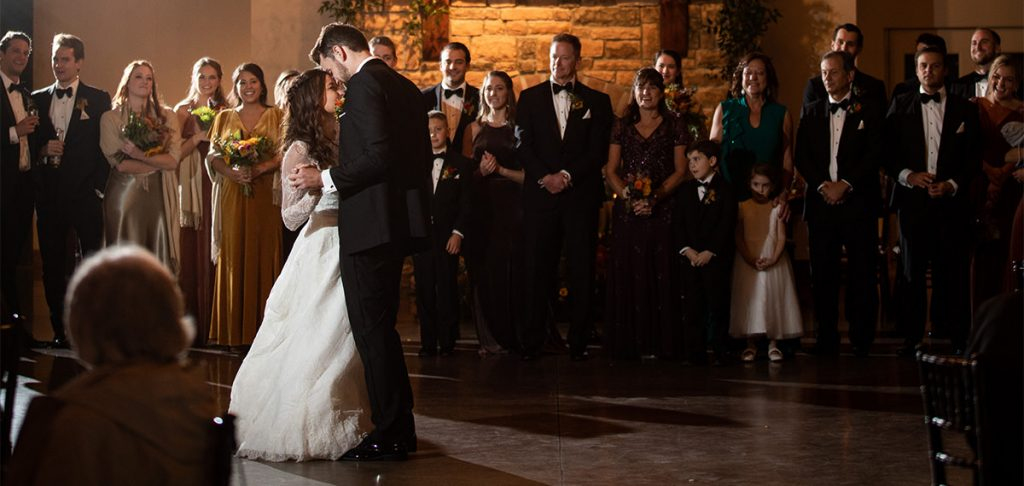 A couple dancing their first dance at their wedding. Tey are dancing to one of their favorite songs.
