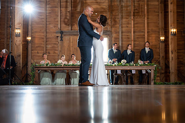 A couple doing their first dance at a wedding reception.
